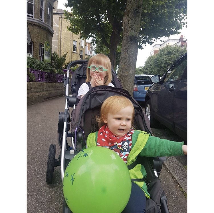 Two children in a double buggy