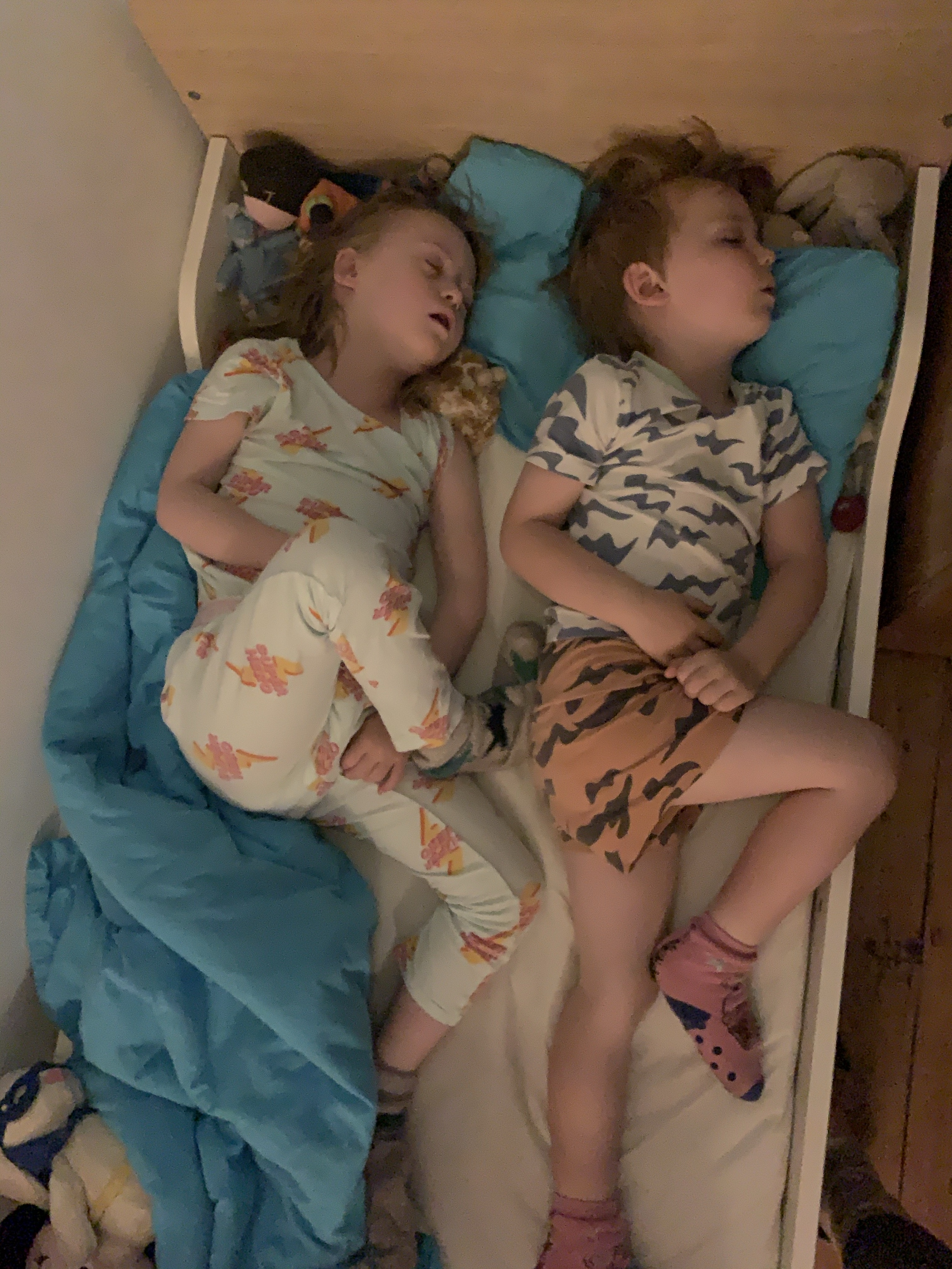 Sister and brother asleep